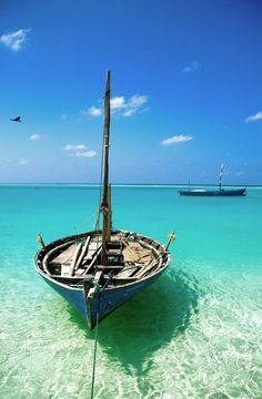 Take me there ;)  Swoon to the coastal sea greens and the wooden boat x