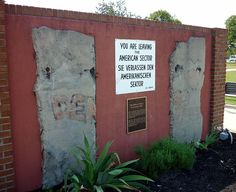 "Display of two sections of the wall and a ""You are leaving"" sign at Fort Gordon, Georgia"