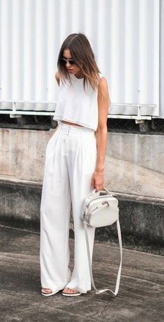 Flowy white pants and a cropped white top. This all-white look is perfection.