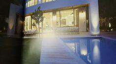 Off center swimming pool