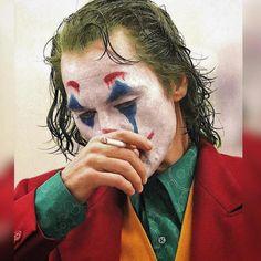 Joker is a movie starring Joaquin Phoenix, Robert De Niro, and Zazie Beetz. In Gotham City, mentally troubled comedian Arthur Fleck is disregarded and mistreated by society. Comic Del Joker, Le Joker Batman, Joker And Harley Quinn, Batman Comics, Joaquin Phoenix, Photos Joker, Joker Images, Joker Film, The Joker
