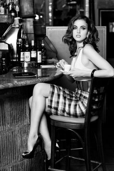 this photo is perfect..her hair, makeup, outfit and she is having an espresso..