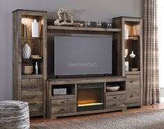 Trinell Entertainment Wall W/ Glass And Stone Fireplace Signature Design   Furniture Cart