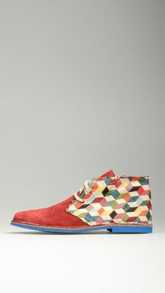 Multicoloured square quarters embellished red suede lace-ups desert boots featuring leather midsole, antioxidant eyelets, desert boots manufacturing process, raw edge stitching, contrast blue rubber sole, 100% finest canvas and suede.