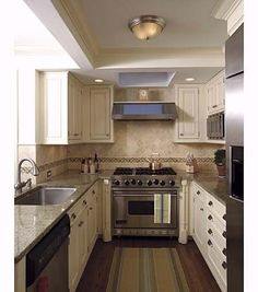 I love these color cabinets for a small kitchen!  Michael Luppino | thisoldhouse.com | from Efficient Galley Kitchens