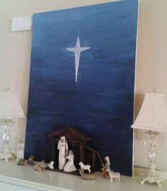 Good idea for background over nativity...squirted black, navy, blue, then light blue in stripes across the canvas going from darkest at the bottom to lightest at the top and blended away until I had a nice gradated look, akin to a night sky. Once that was dry, I added a star.