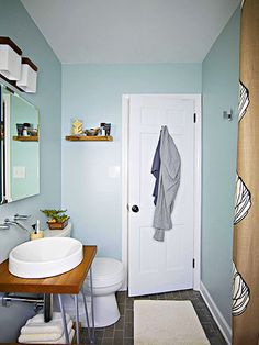 This homeowner is decidedly unfussy when it comes to prep time. Razor, comb, toothbrush, towel, and soap often suffice. He has all the storage space he needs with a towel basket, a medicine cabinet, and a small shelf. DIY Tip: When laying floor tile, find the center, install that row, and work out to the edges./