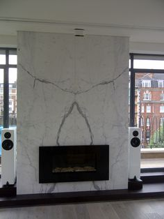 Cut from the famous Italian marble Statuario, this fireplace in Westminster was booked matched creating a symmetrical veined pattern as the main feature in the room Stone Fireplace Wall, Dining Room Fireplace, Marble Fireplaces, Modern Fireplace, Fireplace Design, Fireplace Mantels, Tv Wall Decor, Glass Railing, Italian Marble
