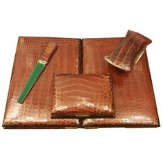 Hermès Paris Crocodile Skin Four-Piece Desk Set French Art Deco | From a unique collection of antique and modern desk accessories at https://www.1stdibs.com/furniture/decorative-objects/desk-accessories/