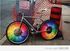 When I get my first grown-up bike I'm going to do this. Really.  When i was a kid we used clothes pegs to hold playing cards on the spokes, or collected colored foil bottle caps from glass milk bottles and folded them on to create patterns.