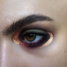 gold, plum and green eye make up