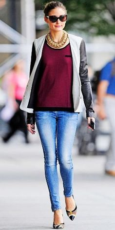 Olivia Palermo hit the street in a scoopneck sweater that she teamed with a leather topper, statement necklace, skinny jeans and cap-toe pumps.