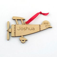 Our personalized wooden Airplane Ornament is perfect for babys first Christmas or any child or family that loves vintage planes. Our Graphic