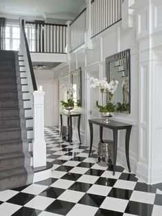 Chic foyer with silver stools tucked under black console tables paired with rect. Chic foyer with silver stools tucked under black console tables paired with rectangular mirrors ove Black And White Hallway, Black And White Flooring, Black Stairs, Black And White Tiles, Black White, White Staircase, Curved Staircase, White Gold, Design Entrée