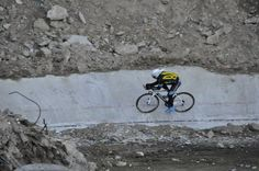 Ukrainian track cyclist training on remains of bombed out velodrome. Shows how lucky we are in UK.