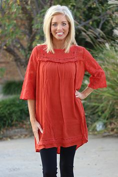 """Our Pumpkin Patch Lace Tunic is made of 60% Cotton and 40% Polyester and measures approximately 34"""" long from shoulder to hem.  This tunic is available in sizes Small, Medium, and Large."""