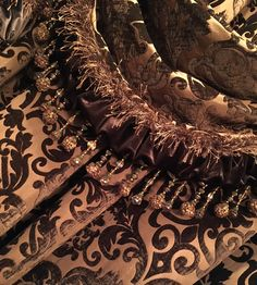 Detail of Reilly-Chance Collection Luxury Drapery: Opulence Panel & Swag. Featuring chocolate brown toned chenille and velvet, embellished with faux mink and beading.