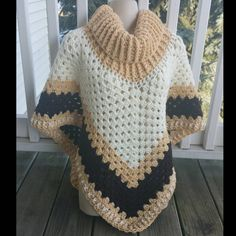 Hot Off My Hook! Project: Cowl Neck Poncho Started: 21 Dec 2015 Completed: 23 Dec 2015 Model: Madge the Mannequin Crochet Hook(s): 7mm, Cowl portion, K, Granny Stitch portion Yarn: Crafter's Secret Color(s): Dark Ivory, Magnolia Way, Warsaw Pattern Source: Simply Crochet Magazine, Issue No. 25 (Hard Copy) Pattern Designed By: Simone Francis Notes: This is my 61st Poncho and a surprise gift for my Doctor!