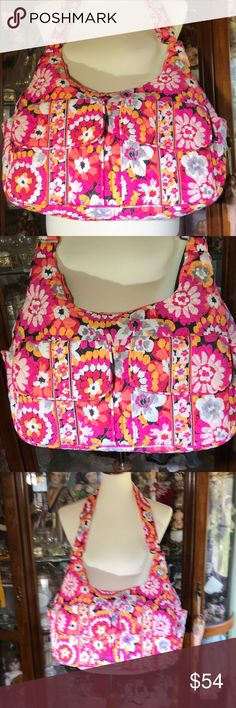 Gorgeous Vera Bradley hobo bag Gorgeous Vera Bradley bag in Pixie Blossoms. This bag is large, so plenty of room for lots of stuff. Colors are Orange, dark pink , white and black. I have the back pack in this pattern and it looks fabulous when wearing black. This is a gently used bag still in very good condition  straps look great as well as bottom and inside. The fabric is still bright and crisp. Vera Bradley Bags Hobos