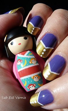 Nail art with purple an gold French manicure
