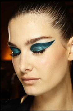 Incredible blue cat-eyes at Versace fall 2014 couture