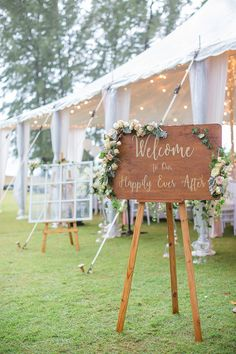 "Wedding marquee with white and yellow decor and brown sign Welcome to the happily ever after // Wedding Boutique Phuket dreamt up a vintage European ""Key of Love""-inspired celebration on the beachfront lawn of Renaissance Phuket Resort & Spa, Thailand, for David and Ivy. Captured by Darinimages, this wedding theme came complete with vintage key motifs, shades of Rose Quartz and Serenity Blue, and a vintage door ceremony backdrop opening out into the sea."