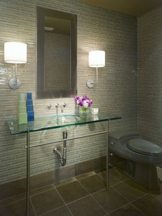 wall of glass tile, glass vanity top with chrome legs/sconces