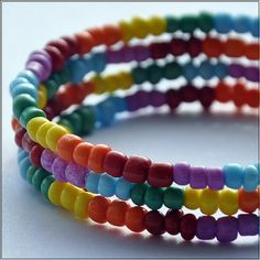 What's more intense than a double rainbow? Only a triple rainbow! $16.00 This memory wire coil bracelet is about three loops wide, depending on wrist size. It features a triple alternating pattern of seed beads in red, orange, yellow, green, blue and purple. Memory wire is awesome because: 1) It is incredibly sturdy and durable. It can take much more abuse than your average bracelet. 2) It doesn't unclasp or fall off, making it harder to lose! 3) The bendy nature of the wire makes it easily…