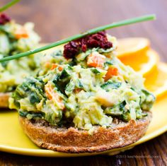 Veggie-Loaded Avocado White Bean Salad      1 16 oz. can white beans (cannellini) - drained, rinsed  1 small avocado, diced  1/3 cup sweet onion, diced  1 small carrot, chopped  1/2 cup spinach, thinly sliced  1 tsp apple cider vinegar  1 lemon, juiced  2 tsp white miso paste  1 Tbsp fresh tangerine or orange juice + pinch of zest  2 Tbsp nutritional yeast  1 Tbsp hemp or sunflower seeds  pinch of cayenne pepper  salt + pepper to taste    topping: harissa + fresh chives