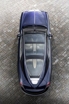 influenced by the coach built rolls-royces of the 1920s and 1930s, the client's desire was for a two seater coupé featuring a large panoramic glass roof.