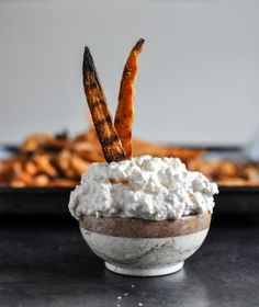Garlic butter sweet potato fries with creamy feta dip