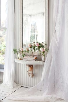 Shabby chic mirror, white lace curtains, and pink roses in glass bottles! Love!!!