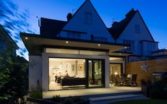 Remodelled family home in Wandsworth by Granit Architects. Project features a new extension spanning the full width of the ground floor with large glass sliding doors and clerestory windows above Bungalow Extensions, House Extensions, Thatched House, Clerestory Windows, Good House, Ground Floor, Interior Architecture, Living Room Designs, Building A House