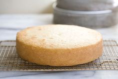 """How To Bake A Flat Cake (uses old towels and safety pins instead of buying those fancy """"bake-even"""" strips)"""