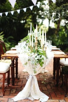 lush greenery and candles centrepiece