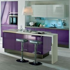 A slim breakfast bar lends an extra function to this violet laminate island.....love ~P~