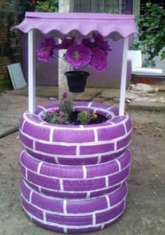 Recycle old tires into an adorable wishing well planter! First,paint the tires with exterior quality spray paint.Use a base coat of whatever color you prefer, then add white lines to make the illusion of bricks. .Cut a square hole into the tires in a vertical line. These are going to be where you insert your…
