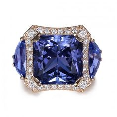 Beautiful Tanzanite Ring. Love the design...Want The Ring!!