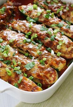 Chicken Enchilada Stuffed Zucchini Boats | Skinnytaste~T~ Love these. I have made them with chicken, ground turkey and turkey sausage.