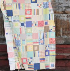 """Divine fabric choices in this """"Squares and Strips Bed Quilt"""" by Allison Harris of Cluck Cluck Sew."""