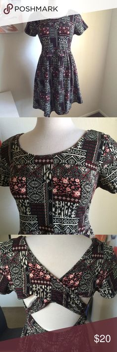 Aztec dress Super cute! It's an Aztec patterned dress. It's black with cream and red. It has short sleeves. The back has a criss cross feature and open back. Very stretchy and comfortable. New without tags. 95% cotton and 5% spandex. Can fit 2x. Forever 21 Dresses
