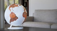 luke calder handcrafts borderless + wordless copper globes. Wanting to portray the true value of land and water, each globe is designed using a patina finish which over time creates an organic and changing piece of art.
