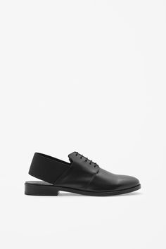 ELASTIC BLACK SHOES - COS STORES    These classic lace-up shoes are updated  with a modern elastic panel across the back. Made from smooth leather d996a00b66