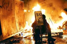 "This image juxtaposes the struggle for the Black Lives Matter to remove itself from the media-stimulated ""riot"" reputation. Since the movement is grassroots there is no leadership to organize the protests, leading to rioting and looting that gets attached to the movement's name."