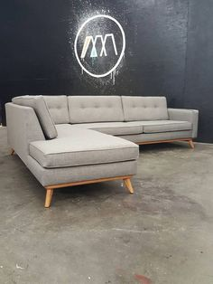 Custom built to order Mid Century Modern Sectional Chaise (chaise can be built on either side). All built in house from the ground up to your design.