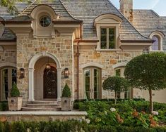 Love the roof line and the french doors across the front of the house! Gorgeous! #ClassicExteriorDesign