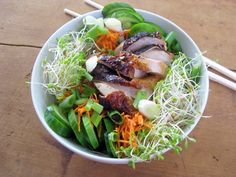 vietnamese bun:   the Vietnamese dish of lettuce, rice noodles, sprouts, and lots of crispy vegetables, with a gingery sauce