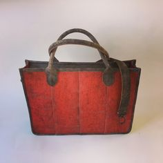 Laptop bag made of used firehose and leather