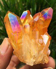 Orange rainbow titanium aura quartz crystal cluster