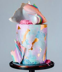A true masterpiece! Pastel colourful cake with rose gold detailing... dreamy! This would be perfect for a unicorn party.
